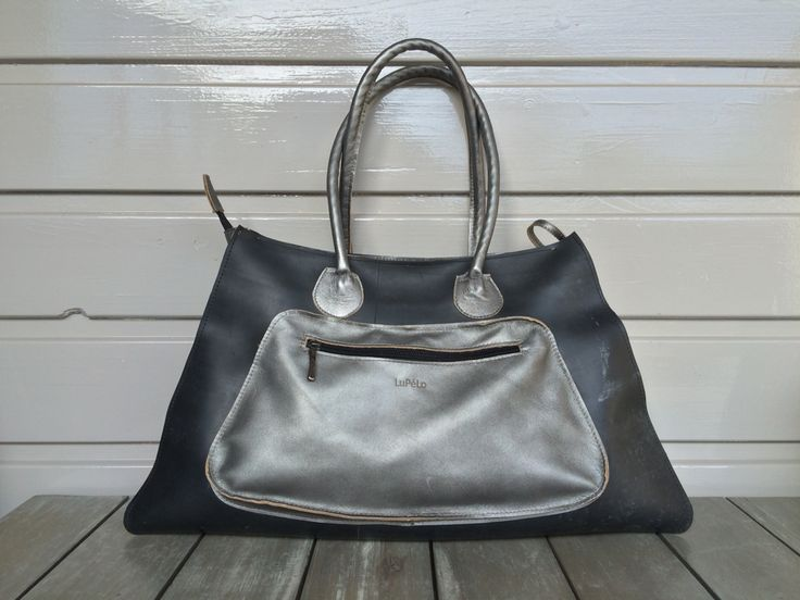 Big shopper, made of used tractor innertube and silver leather.