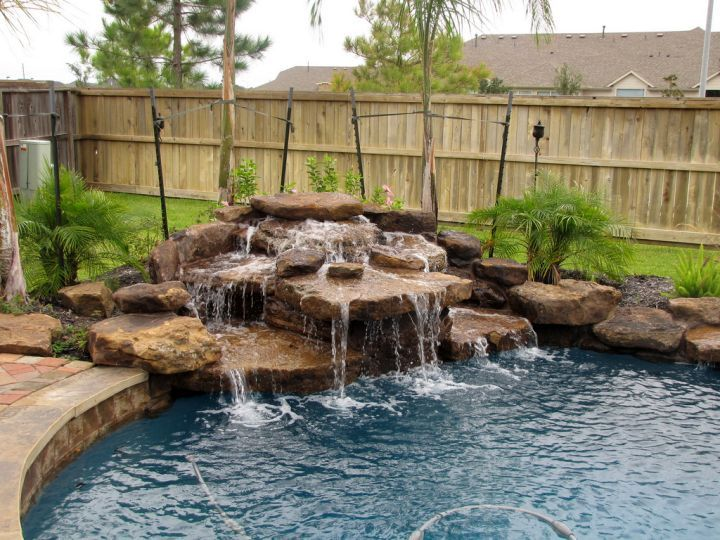 Get inspired with this amazing photo of pool waterfall ideas in the corner. You can't be wrong with it.
