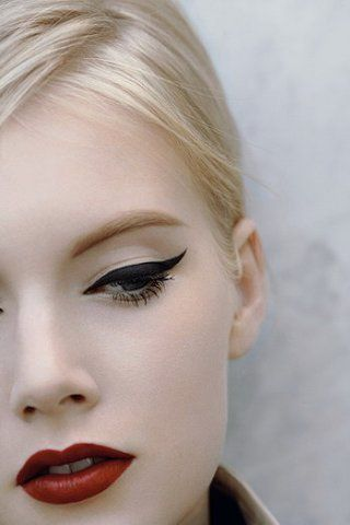 This cat-eye liner and red lipstick: simple, dramatic, perfect.