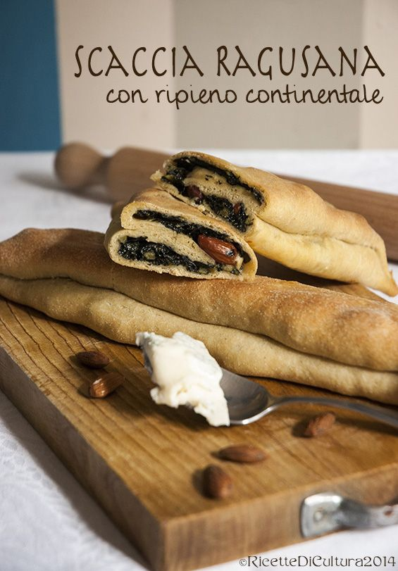 SCACCIA RAGUSANA (Sicilia). It is made with a very thin rectangular dough sheet, folded on itself three or four times and stuffed in different ways. The most common variants are those with cheese and onions,  tomato and onion, tomato and eggplant #food #Italy