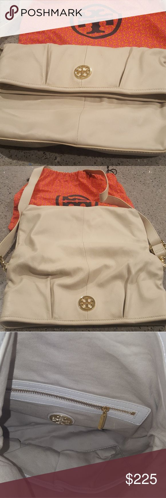 Tory Burch Foldover Crossbody Bag Tory Burch medium foldover cross body bag. Cream with gold hardware. I bought this several years ago and only carried it onces. Its been kept in a dust bag. Its in excellent condition. No stains inside or outside.  Straps are removable. Very roomy inside. Hard wear still shiny & new. Its been sitting in my closet for years. They dont make this bag anymore. Tory Burch Bags Crossbody Bags