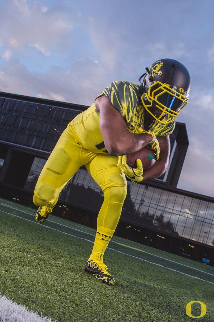 "University of Oregon Ducks 2016 ""Flash of Lightning"" football uniform. Black helmet, yellow jersey, yellow pants"