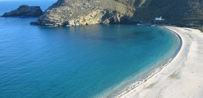 The calm water of Achla Beach is protected by the bay formation.
