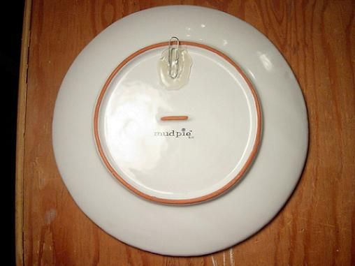 Apparently this blogger has had her plates on the wall, using this method, for 10 years.
