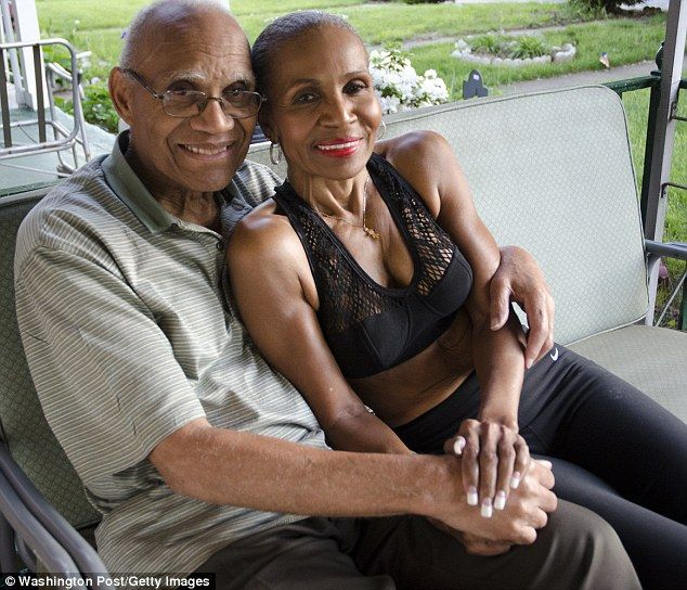 Love and support: Ernestine with her husband of more than 50 years, Collin Shepherd, 83, who runs with her every morning, pictured on the porch of their home in Baltimore, Maryland