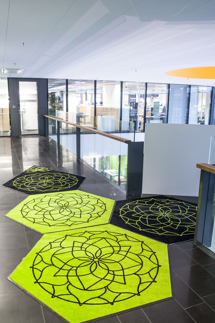 Lindström Group's shaped design mats. With design mats of various shapes, you can add flamboyance to your décor and brand building or control the direction of traffic.  #lindstromgroup #matservices #mat #designmat #interiordesign #carpet #companyimage #brandimage  #shapemats #shapeddesign #hexagon #matrentalservice #rental #customerspecificdesignmat #image