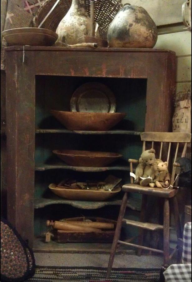 Great brown bowls & cupboard....