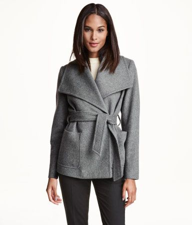 Dark grey, straight-cut, double-breasted jacket in a soft wool blend with wide lapels. Patch pockets at front, single back vent, and tie belt. Lined. Wool content is recycled.   H&M Modern Classics