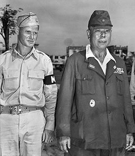 General Tomoyuki Yamashita and an American Military officer. This photo was taken after WW2 where Yamashita was facing war-crime charges under the American Trial Court.