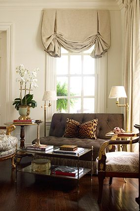 London shade with eclectic pieces.  a little deco fun treatment for window with sparseness of pieces around and neutral wall fabric color