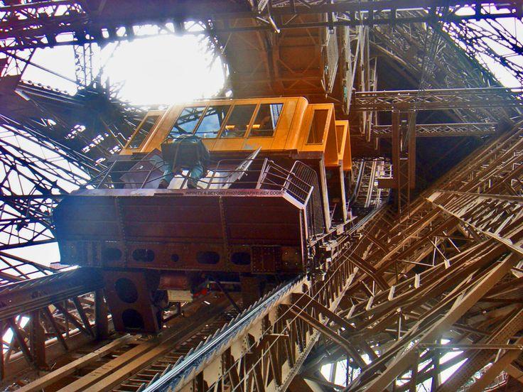 https://flic.kr/p/nKteXQ | Eiffel Tower Cog Rail Lift ascending inside one of the legs.