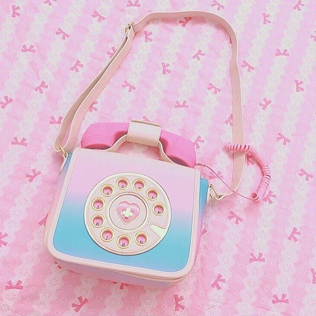 Adorable Betsey Johnson phone purse. Plug into your cell to actually use the phone on the purse!!