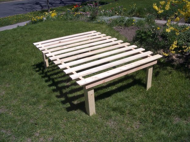 "Picture of Cheap, easy, low-waste platform bed plans  consider using 4""x4"" on sides and attach pre-made legs."