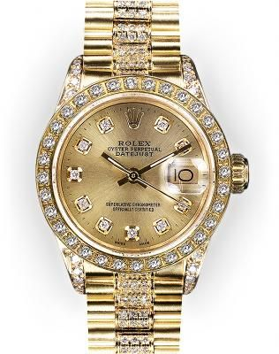Ladies Champagne Dial Rolex Super President (404)    The Gold Ladies' Rolex Super President is a very unique Rolex model. The President bracelet appears bold and powerful, giving the watch a modern look currently very popular among today's professional women. Other popular dial colors: mother of pearl, pave diamond, and silver.