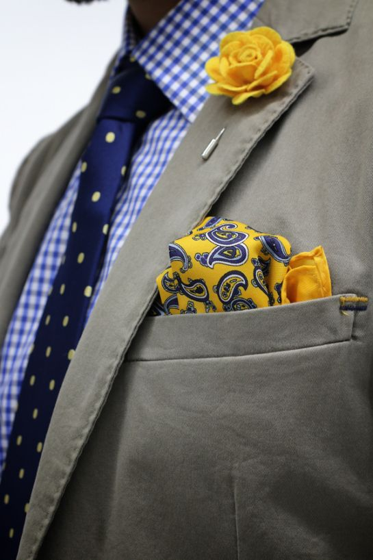 "Mens Fashion - Khaki blazer, checked shirt, polka dot tie, yellow lapel flower, paisley pocket square. Lapel flowers are the new ""it"" item, finishing touch...you were already wearing a pocket square, right? See charmainsmith.jhilburn.com"