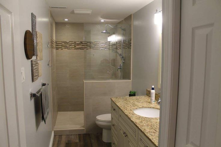 Basement bathroom with heated floor and 60 - inch vanity