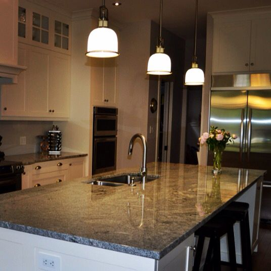 Love the large island and the pendulum lighting! Lots of cabinet space