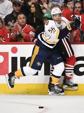 Nashville Predators left wing Kevin Fiala (56) and Chicago Blackhawks left wing Ryan Hartman (38) collide in the first period of game one in the first-round NHL playoff series at the United Center, Thursday, April 13, 2017, in Chicago, Ill.  Andrew Nelles / The Tennessean