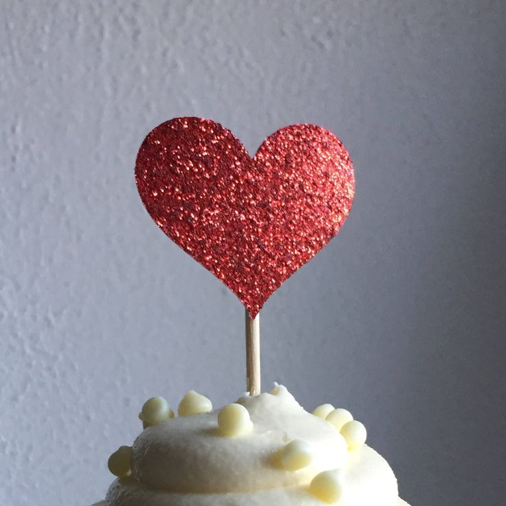 A personal favorite from my Etsy shop https://www.etsy.com/listing/229854561/12-heart-cupcake-toppers-sparkling-red