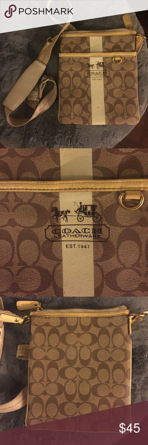 Brown and cream COACH swingpack In good condition brown/cream COACH swingpack. Has one dirty spot but should be able to come off at the dry cleaners. Coach Bags Crossbody Bags