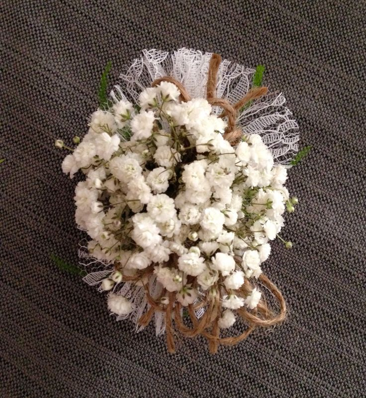 Babies breath wrist corsage with white lace and jute twine. Perfect for a rustic country wedding. Floral design by Barbara Colson.