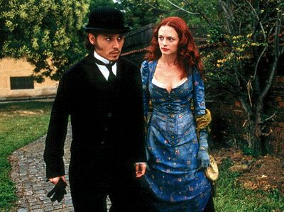 Johnny Depp as Frederick Abberline and Heather Graham as Mary Jane Kelly in From Hell (2001).