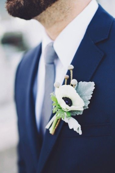 White anemone boutonierre | Romantic & Natural Beach Wedding Ideas via TheELD.com