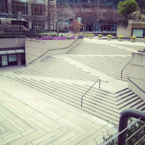 Great example of attractive accessibility, combining stairs and ramp: Robson Square by Arthur Erickson.