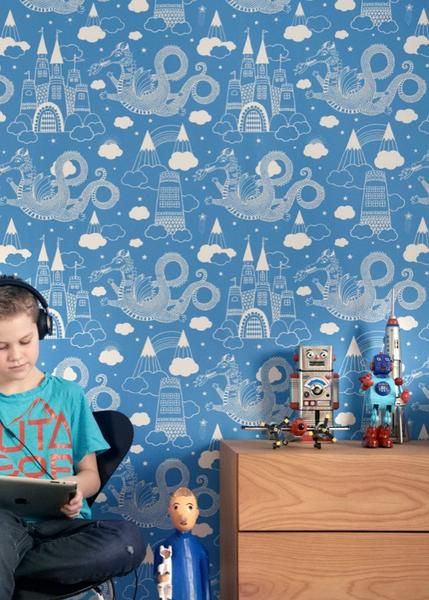 """Majvillan Wallpaper Company brings us this brilliant blue children's wallpaper """"Dragon Sky"""" 103-01 where fire breathing dragons dance in-between the castles in the clouds  Non-Woven Wallpaper (paste the wall)  Washable & Eco-Friendly  Roll Size: 10m x 53cm  Repeat: 53cm Straight Match  In-stock"""