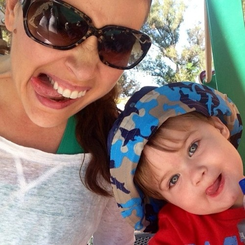 Alyssa Milano and her little tike, Milo. He is even cuter wearing an Ocean Camo Reversible bucket hat!   #uvskinz