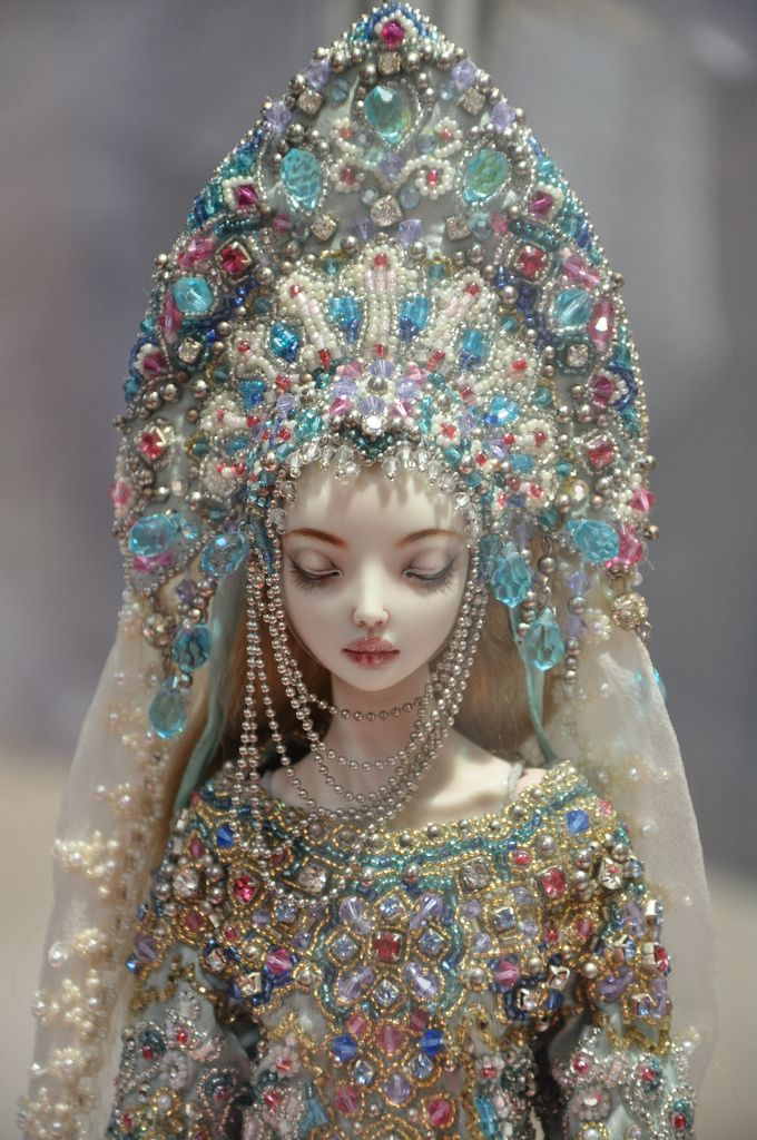 """Enchanted Dolls by Marina Bychkova ~ Snegurochka, 2004-2009. Materials: Bead embroidery on fine silk with 476 Swarovski crystals, 76 Rhinestones, 1045 metal spheres, over thirty thousand glass seed beads. Porcelain, ball jointed, china paint, industrial springs, mohair wig, leather. 13.5"""" (34.5cm) tall."""