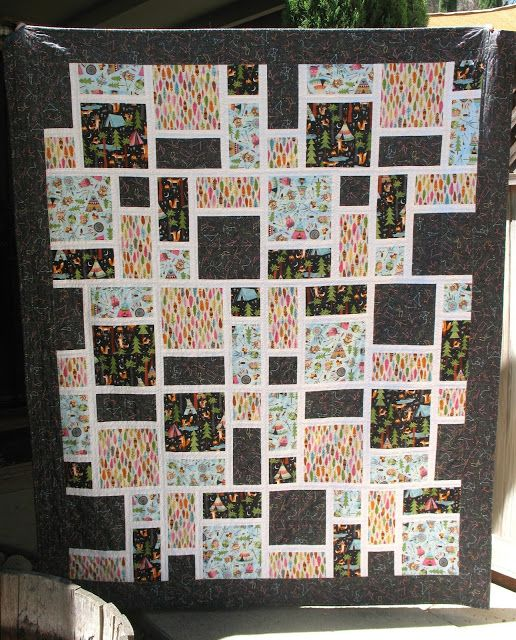 Forest animal quilt made with squares, rectangles, 1/2 ...