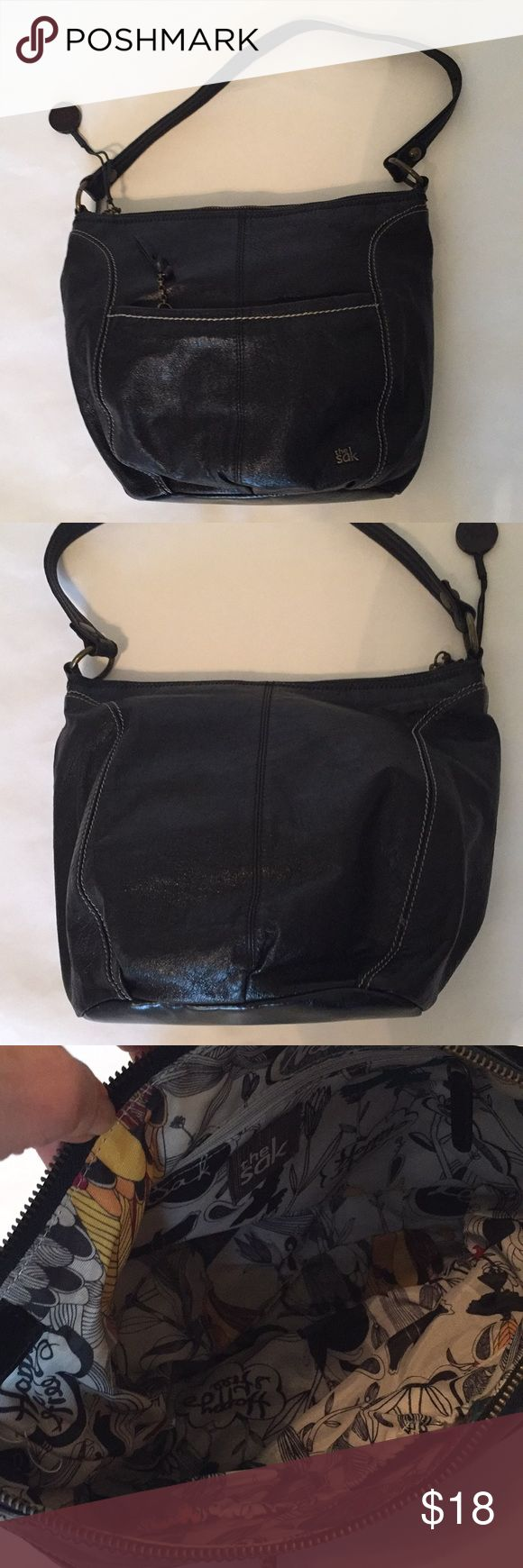 """EUC The Sak black leather purse Sak black leather purse/shoulder bag. 14"""" x 19"""" x 4"""" at base. Outside zippered pocket, 100% leather body, 100% poly lining with Sak design. Inside has one zippered pocket and 2 slip pockets. Handle has 10"""" drop. Excellent condition, no signs of wear. The Sak Bags Shoulder Bags"""
