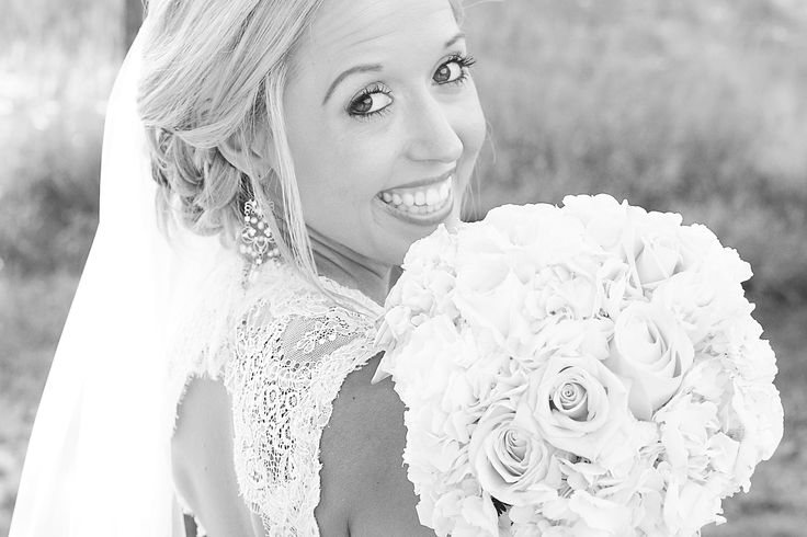 Wedding photography. bridal pose. Lace wedding gown. marriage. outdoor wedding. undo. vail and bouquet