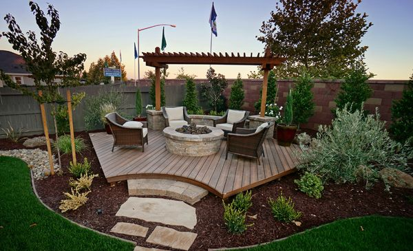 Backyard corner deck with fire pit and landscaping ideas - Love this beyond words.