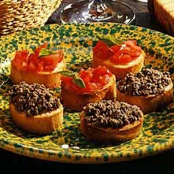 """(Crostini di Fegatini)         Crostini means """"little crusts,"""" and in Tuscany, almost every meal begins with a platter of toasted bread slices topped with chopped tomatoes, olive paste or this all-time favorite spread made with chicken livers. Use thin slices of an Italian or French country-style loaf, and serve these crostini with the chicken liver spread on top, or just present the pâté in a pretty bowl surrounded by the toasted baguette slices. Salami and prosciutto would be deli..."""