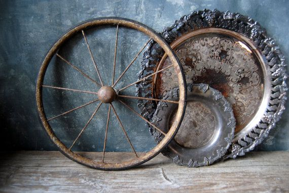 Antique Farmhouse Cart Wheel by Untried on Etsy. Wow this piece looks amazing. It would be a great addition to any other industrial decor. Check it out here: https://www.etsy.com/listing/241797879/antique-farmhouse-cart-wheel-metal-and?ref=tre-2725134567-4