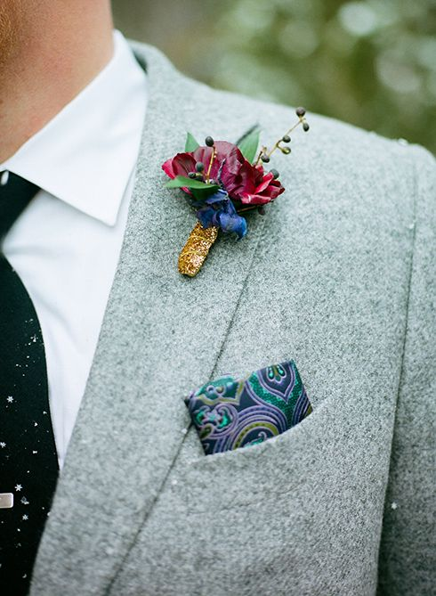 Snowed In: Lapel boutonniere coordinated with his paisley pocket square.