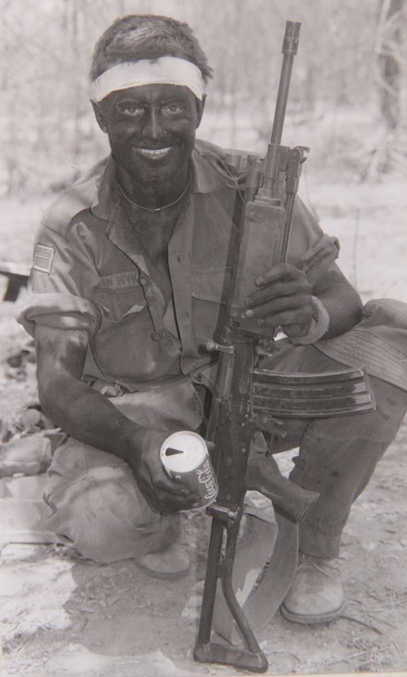 SADF trooper with his R4 assault rifle...