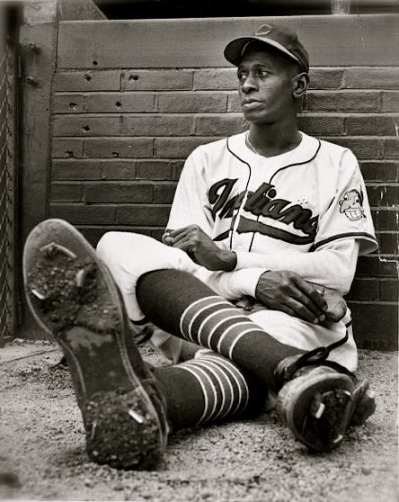 "Leroy ""Satchel"" Paige, the first Negro League player elected to the Baseball Hall of Fame. Paige signed with the Cleveland Indians in 1948 and two days later became the oldest rookie and the first Black to pitch in an American League baseball game.'"