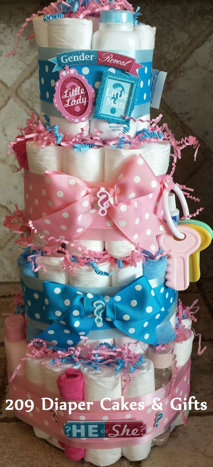4-Tier Pink & Blue Gender Reveal Diaper Cake by 209 Diaper Cakes & Gifts
