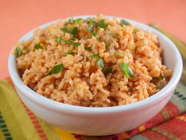 Cheesy Mexican Rice - CDKitchen.com -  This simple side dish is made with instant rice, salsa, chicken broth, and cheese.
