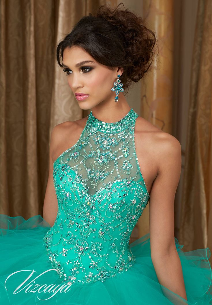 Tulle Quinceañera Ballgown. High Halter Neckline with Beading and Corset Back. Matching Bolero included. Colors Available: Fuchsia, Mint Leaf, Cobalt, White