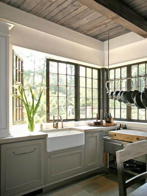 Swing-out back splash windows wrapping the kitchen must have beautiful garden/back yard to look at