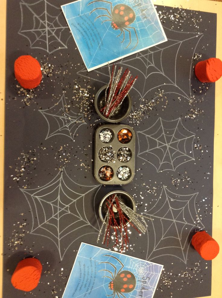 Spider playdough- an invitation to learn. Red sparkly play dough, pipe cleaners, google eyes, spider sequins, black paper with webs and white and silver pencils to encourage marking.