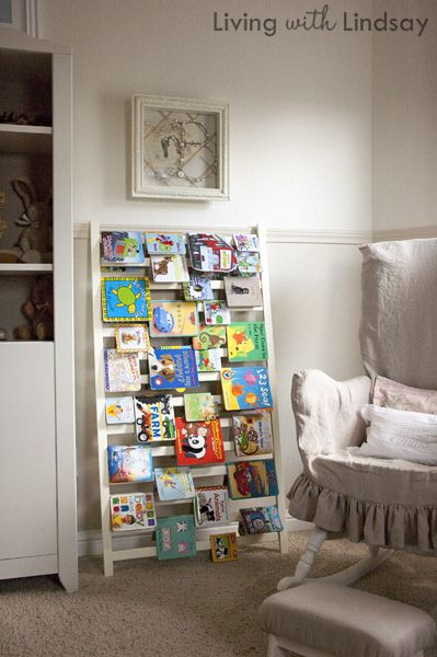Turn an old crib rail into a bookshelf!  Wish I had seen this before I threw away our old crib.....