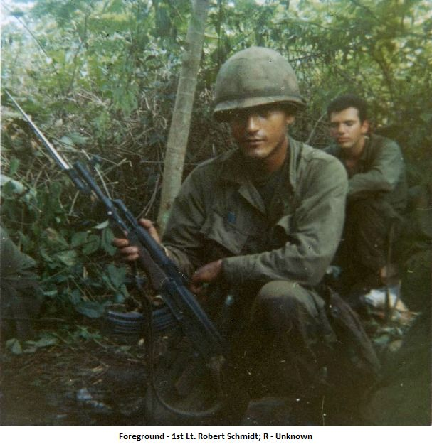 """In the foreground, 1st Lt. Robert Schmidt; on the right, unknown."" ~ Vietnam War"
