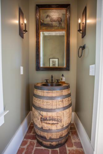 Jack Daniels Whiskey barrel sink in this Alabama ranch bathroom