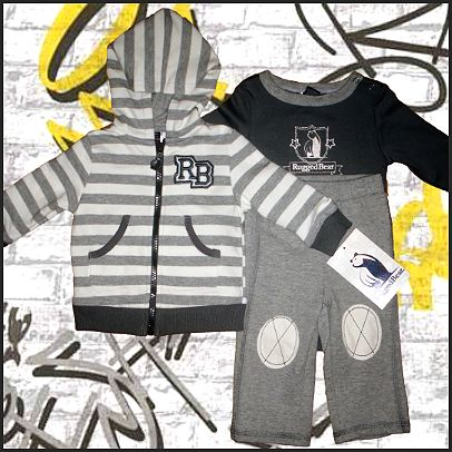 Grey 3 Piece Warm Up Set By Rugged Bear. Stylish and cool! This fabulous 3 piece coordinating warm up suit by rugged bear features a long sleeve grey/cream onesie, matching grey track pants and a striped hooded jacket. Made of 100% cotton, it's the perfect choice for cooler seasons!