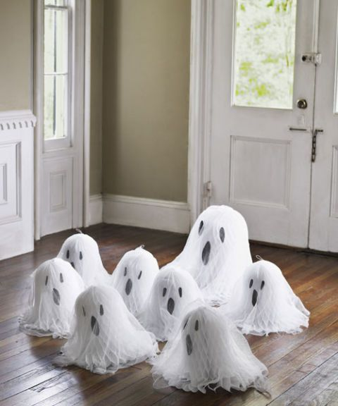To call forth this gathering, use glue dots to stick construction-paper eyes and mouths onto white tissue-paper bells, then drape them with cheesecloth.